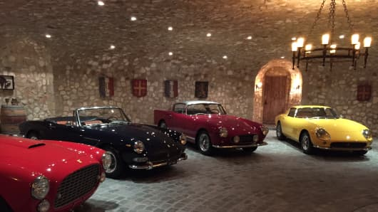 This man cave has tons of luxurious details, including room for its owner's car collection.